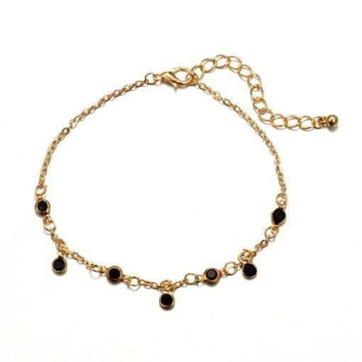 bracelet dore pierres noires